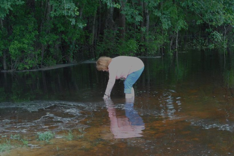 Brenda Sutton Rose, author of DOGWOOD BLUES, love to put her hands and feet in the water of the Alapaha River in South Georgia.